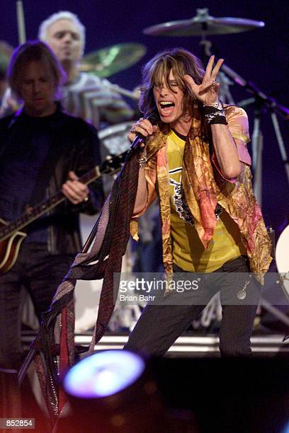Steven Tyler of Aerosmith performs during the halftime show January 28 2001 for Super Bowl XXXV at Raymond James Stadium in Tampa Florida