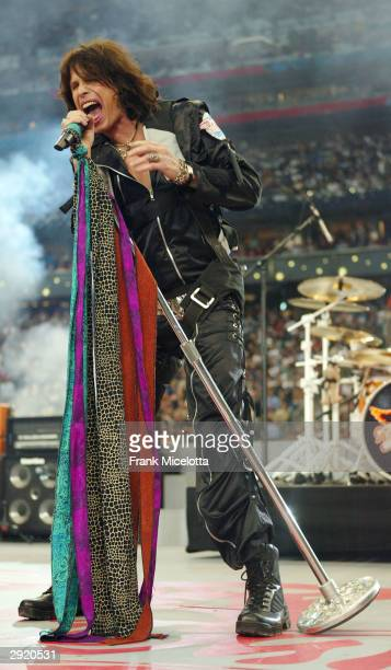 Steven Tyler of Aerosmith performs during the pre-game show prior to the start of Super Bowl XXXVIII between the New England Patriots and the...