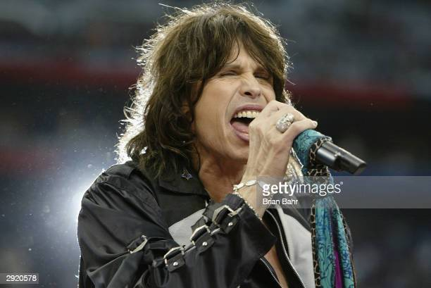 Steven Tyler of Aerosmith performs during the pregame show prior to the start of Super Bowl XXXVIII between the New England Patriots and the Carolina...
