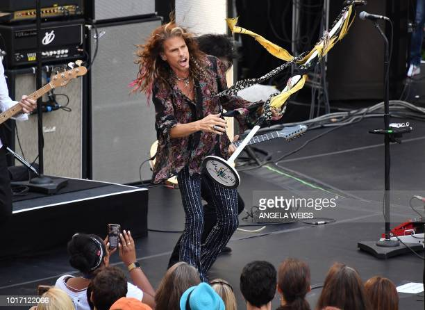 Steven Tyler of Aerosmith lifts Al Roker up on stage on NBC's 'Today' show at Rockefeller Center on August 15 2018 in New York City