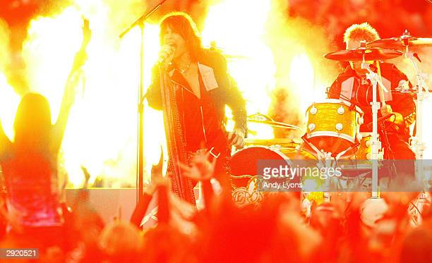 Steven Tyler of Aerosmith performs prior to the start of Super Bowl XXXVIII between the New England Patriots and the Carolina Panthers at Reliant...
