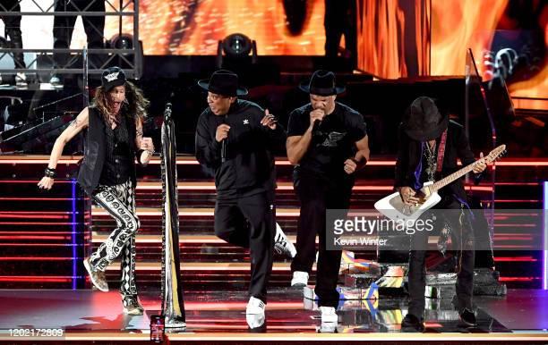 Steven Tyler of music group Aerosmith Joseph Simmons and Darryl McDaniels of music group Run–DMC and Joe Perry of music group Aerosmith perform...