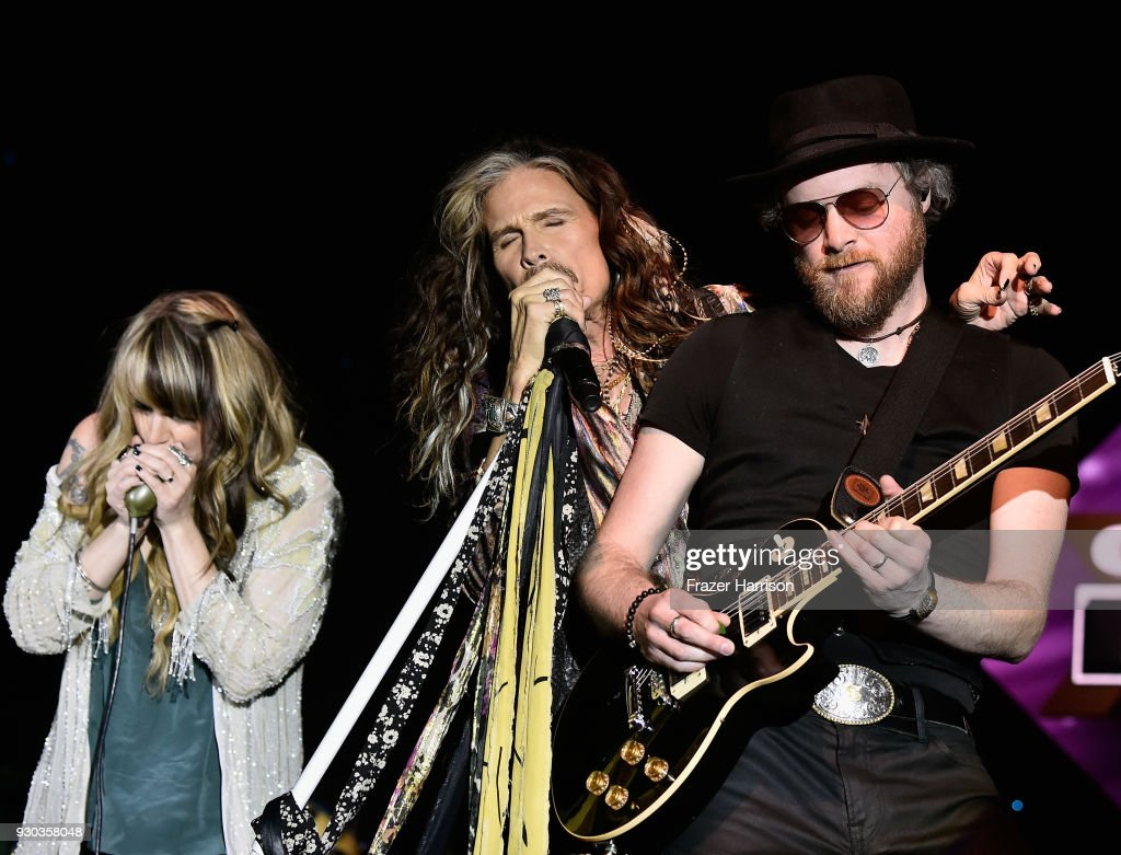 Steven Tyler (C) performs onstage at Celebrity Fight Night XXIV on March 10, 2018 in Phoenix, Arizona.