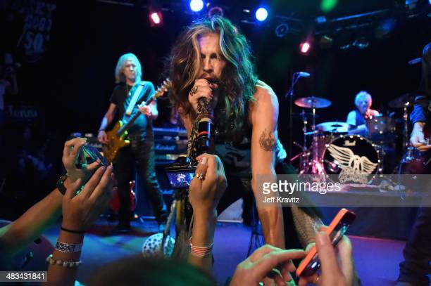 Steven Tyler performs onstage during Aerosmith's summer 'Let Rock Rule' tour launch at Whisky a Go Go on April 8 2014 in West Hollywood California