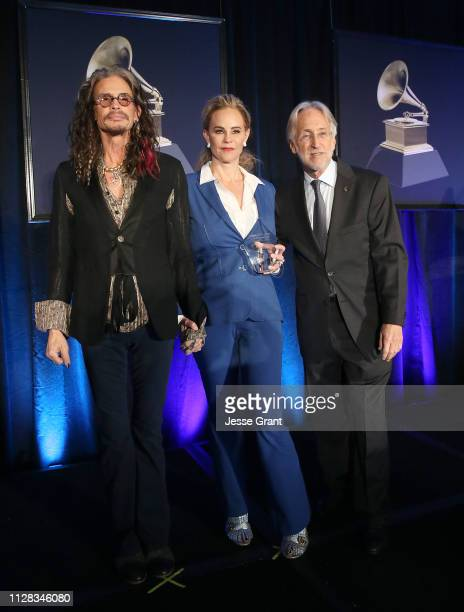 Steven Tyler presented attorney Dina LaPolt with the 2019 Entertainment Law Initiative Service Award alongside Neil Portnow President/CEO of the...