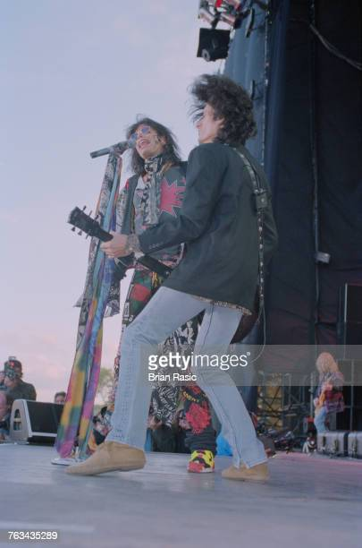 Steven Tyler singer with American rock band Aerosmith performs live on stage with lead guitarist Joe Perry at the 1994 Monsters of Rock festival at...