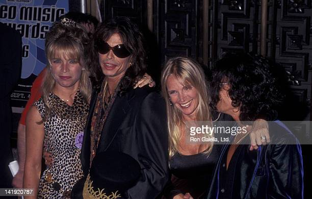 Steven Tyler wife Teresa Barrick and Joe Perry and wife Billie Perry attend 13th Annual MTV Video Music Awards on September 4 1996 at Radio City...