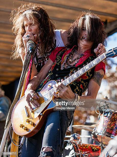 Steven Tylerand Joe Perry of Aerosmith perform during the celebration of the release of their new album 'Music from Another Dimension' and encourages...