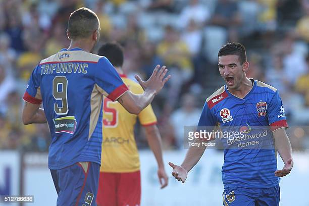 Steven Ugarkovic of the Jets celebrates a goal with team mate Milos Trifunovic during the round 21 A-League match between the Central Coast Mariners...