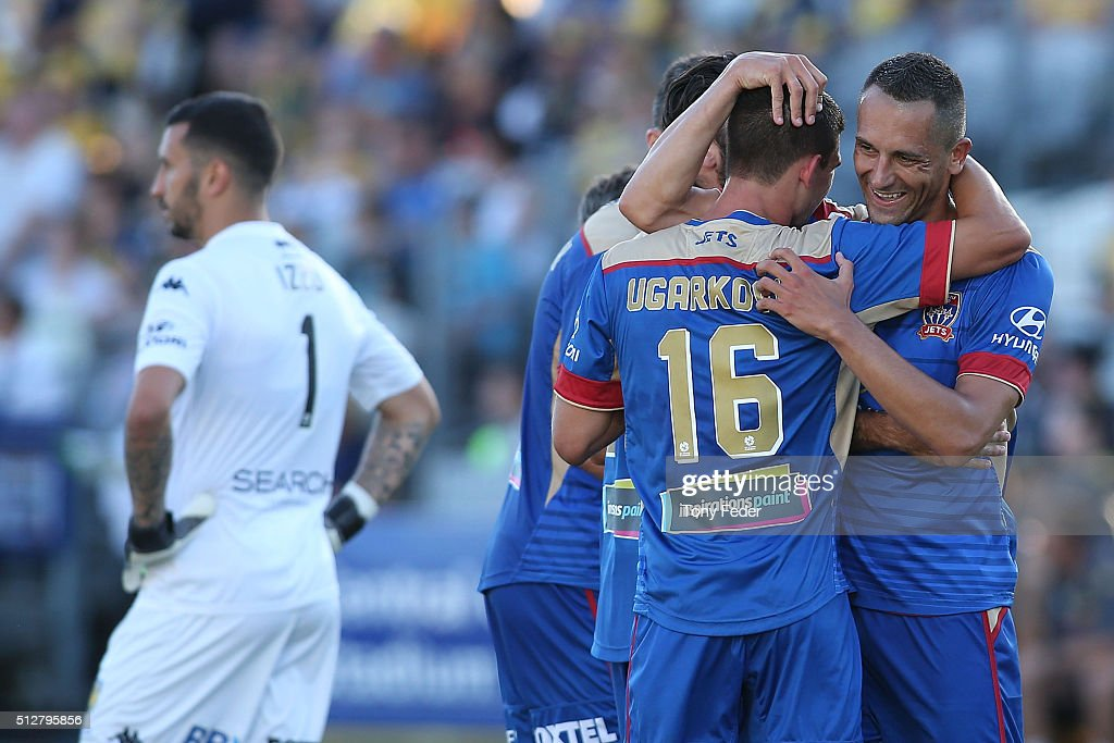 Steven Ugarkovic of the Jets celebrates a goal with team mate Milos Trifunovic during the round 21 A-League match between the Central Coast Mariners and the Newcastle Jets at Central Coast Stadium on February 28, 2016 in Gosford, Australia.