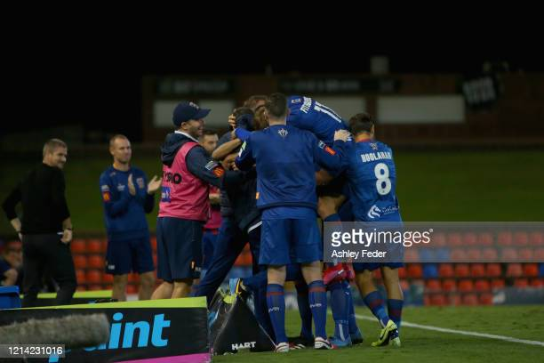 Steven Ugarkovic of the Newcastle Jets celebrates his goal with team mates during the round 26 A-League match between the Newcastle Jets and...