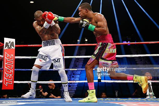 Steven Upsher connects with a right to Ashley Theophane during their junior welterweight fight at MGM Grand Garden Arena on September 12, 2015 in Las...