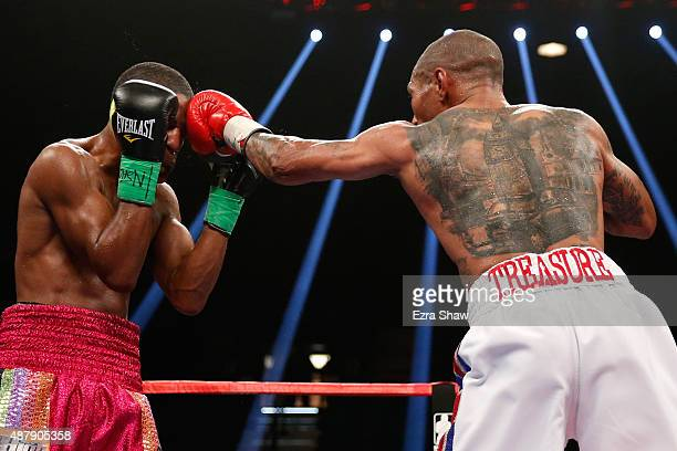 Steven Upsher is hit by a left from Ashley Theophane during their junior welterweight fight at MGM Grand Garden Arena on September 12, 2015 in Las...