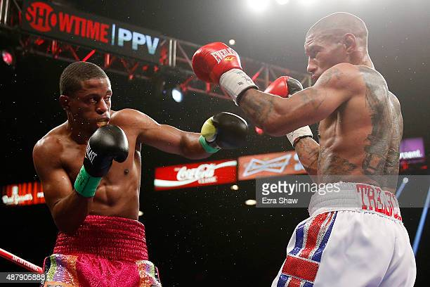 Steven Upsher throws a left at Ashley Theophane during their junior welterweight fight at MGM Grand Garden Arena on September 12, 2015 in Las Vegas,...