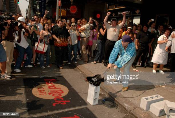 Steven Van Zandt smashes his guitar during Hard Rock Cafe Opens in Times Square with Worlds' Largest Guitar Smash at Hard Rock Cafe Times Square in...