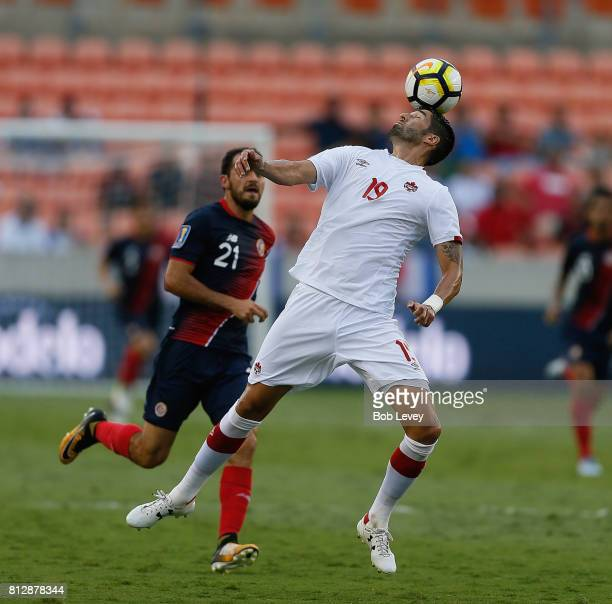 Steven Vitoria of Canada clears the ball away from Marco Urena of Costa Rica at BBVA Compass Stadium on July 11 2017 in Houston Texas