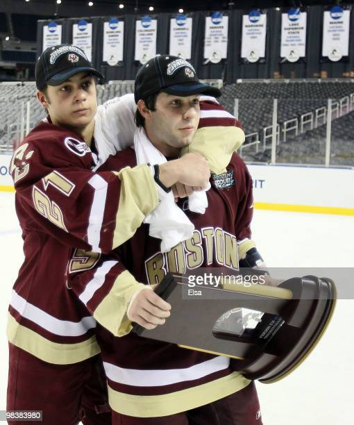 Steven Whitney and Joe Whitney of the Boston College Eagles celebrate with the trophy after the championship game of the 2010 NCAA Frozen Four on...