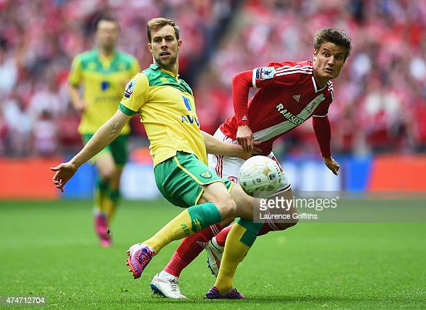 Steven Whittaker of Norwich City and Jelle Vossen of Middlesbrough watch the ball during the Sky Bet Championship Playoff Final between Middlesbrough...