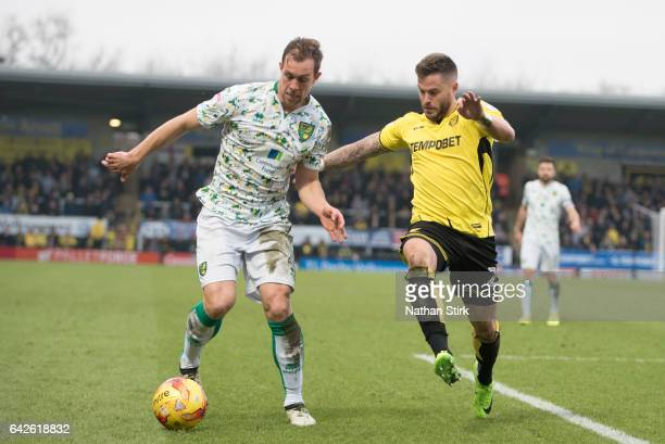 Steven Whittaker of Norwich City and Michael Kightly of Burton Albion in action during the Sky Bet Championship match between Burton Albion and...