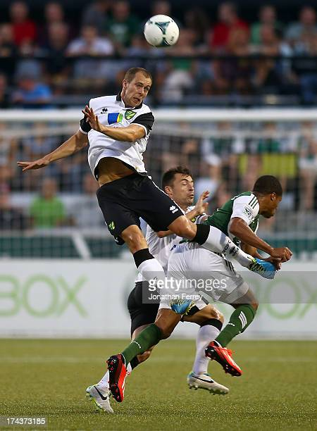 Steven Whittaker of Norwich City goes up for a header against of the Portland Timbers on July 24 2013 at JeldWen Field in Portland Oregon