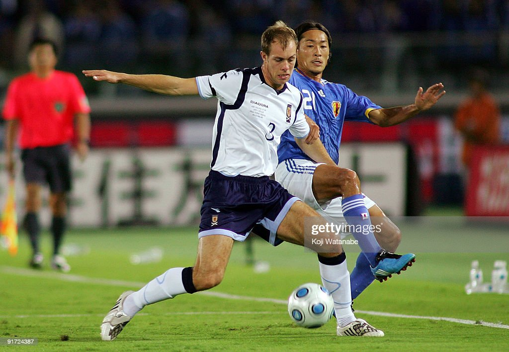 Steven Whittaker of Scotland and Naohiro Ishikawa of Japan compete for the ball during Kirin Challenge Cup 2009 match between Japan and Scotland at Nissan Stadium on October 10, 2009 in Yokohama, Japan.
