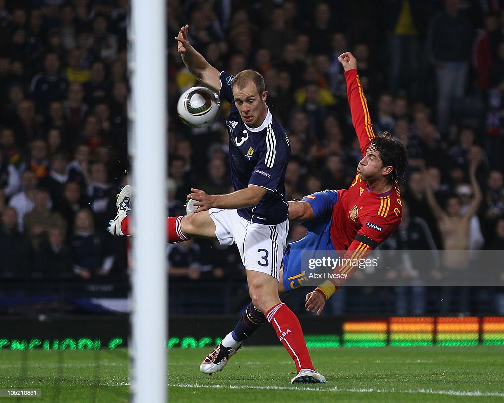 Steven Whittaker of Scotland handballs from a shot by Sergio Ramos of Spain to concede a penalty during the UEFA EURO 2012 Group I Qualifier match between Scotland and Spain at Hampden Park on October 12, 2010 in Glasgow, Scotland.