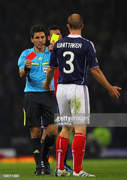 Steven Whittaker of Scotland is sent off by referee Massimo Busacca during the UEFA EURO 2012 Group I qualifying match between Scotland and Spain at...