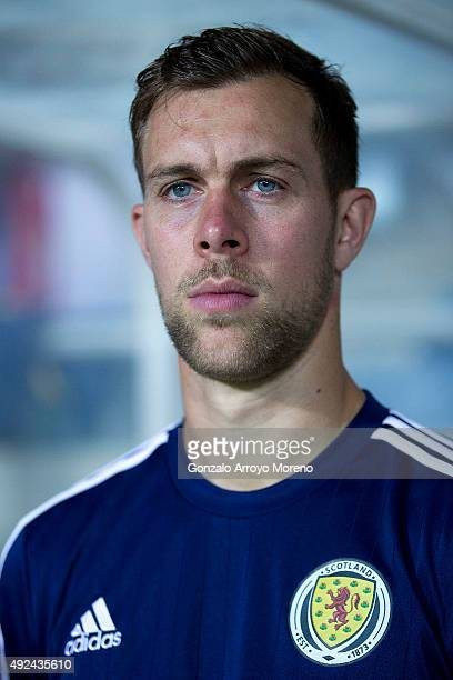 Steven Whittaker of Scotland listens to his National anthem at the bench prior to start the UEFA EURO 2016 Qualifying round Group G match between...