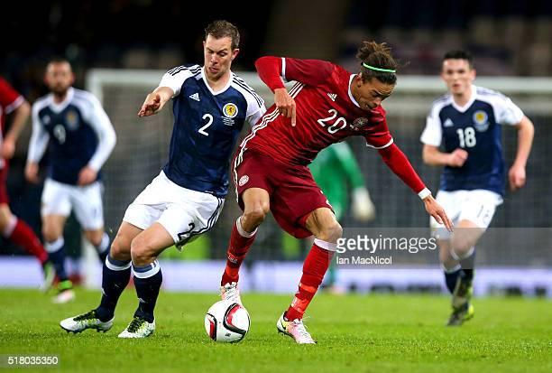 Steven Whittaker of Scotland vies with Jonas loss of Denmark during the International Friendly match between Scotland and Denmark at Hampden Park on...