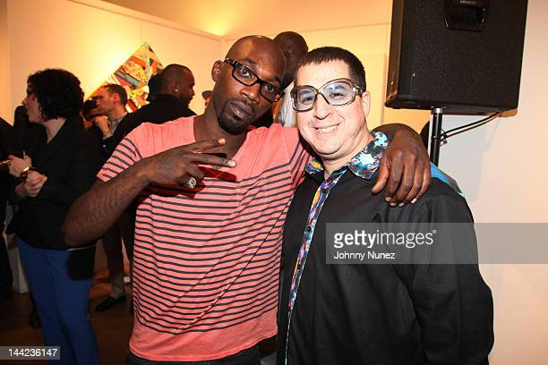 Steven Williams and Noah G Pop attend the 2012 Project Canvas Exhibition Art Gala at The Opera Gallery on May 11 2012 in New York City