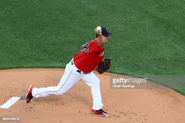 Steven Wright of the Boston Red Sox pitches at the top of the first inning of the game against the Seattle Mariners at Fenway Park on June 22 2018 in...