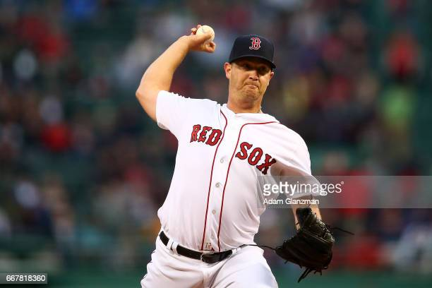 Steven Wright of the Boston Red Sox pitches in the first inning of a game against the Baltimore Orioles at Fenway Park on April 12 2017 in Boston...