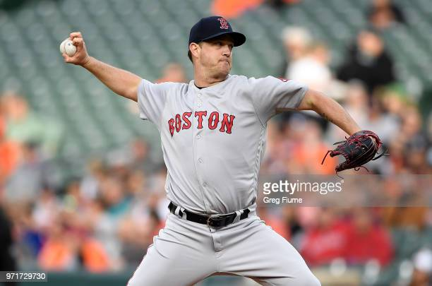 Steven Wright of the Boston Red Sox pitches in the first inning against the Baltimore Orioles at Oriole Park at Camden Yards on June 11 2018 in...