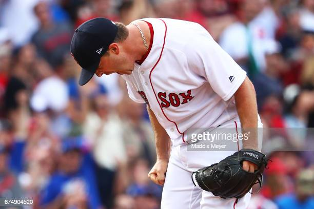Steven Wright of the Boston Red Sox reacts after Anthony Rizzo of the Chicago Cubs hit a tworun homer during the fourth inning at Fenway Park on...