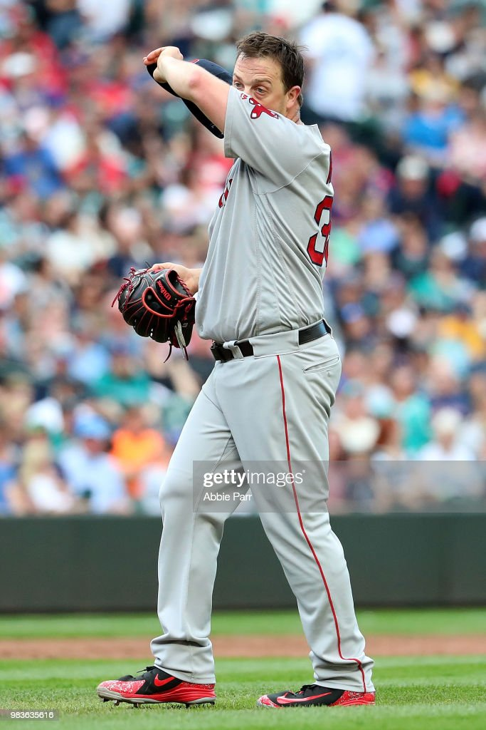 Steven Wright #35 of the Boston Red Sox reacts after giving up a hit in the sixth inning against the Seattle Mariners during their game at Safeco Field on June 16, 2018 in Seattle, Washington.