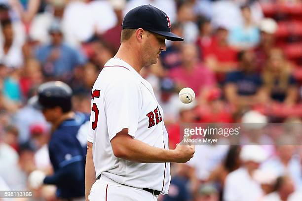 Steven Wright of the Boston Red Sox reacts after Logan Morrison of the Tampa Bay Rays hit a home run during the fourth inning at Fenway Park on...