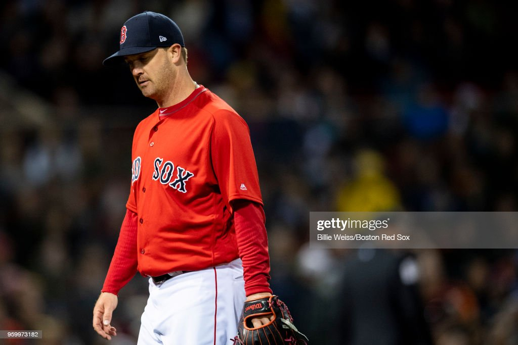 Steven Wright #35 of the Boston Red Sox reacts during the seventh inning of a game against the Baltimore Orioles on May 18, 2018 at Fenway Park in Boston, Massachusetts.