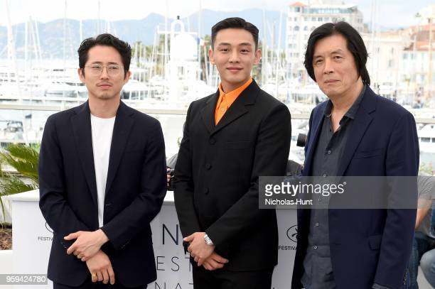 Steven Yeun Ahin Yoo and director Changdong Lee attend 'Burning' Photocall during the 71st annual Cannes Film Festival at Palais des Festivals on May...