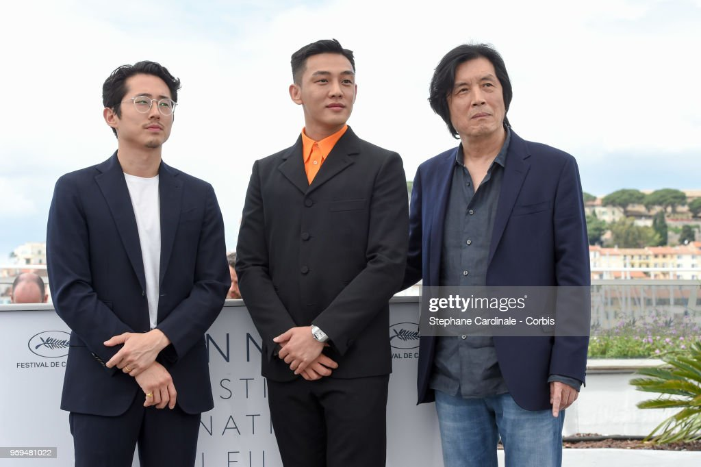 Steven Yeun, Ah-in Yoo and director Chang-dong Lee attend 'Burning' Photocall during the 71st annual Cannes Film Festival at Palais des Festivals on May 17, 2018 in Cannes, France.