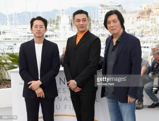 Steven Yeun Ahin Yoo and director Changdong Lee attend the 'Burning' Photocall during the 71st annual Cannes Film Festival at Palais des Festivals on...