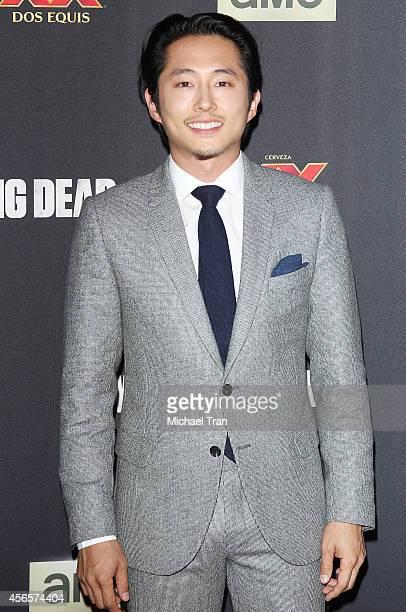 Steven Yeun arrives at AMC's 'The Walking Dead' Season 5 Premiere held at AMC Universal City Walk on October 2 2014 in Universal City California