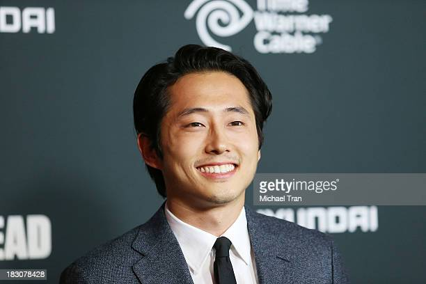 Steven Yeun arrives at the Los Angeles premiere of AMC's The Walking Dead 4th season held at Universal CityWalk on October 3 2013 in Universal City...