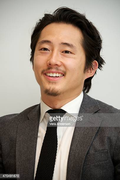 Steven Yeun at 'The Walking Dead' Press Conference at the Four Seasons Hotel on April 20 2015 in Beverly Hills California