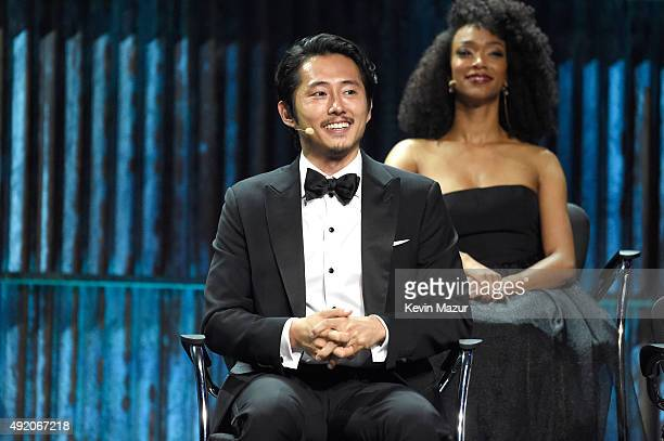 """Steven Yeun attends AMC's """"The Walking Dead"""" season 6 fan premiere event at Madison Square Garden on October 9, 2015 in New York City."""