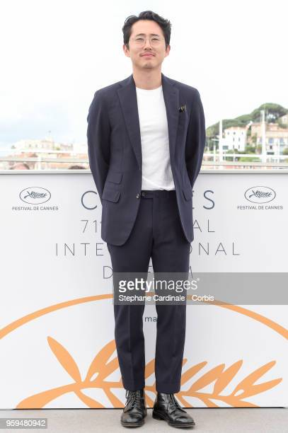 Steven Yeun attends 'Burning' Photocall during the 71st annual Cannes Film Festival at Palais des Festivals on May 17 2018 in Cannes France