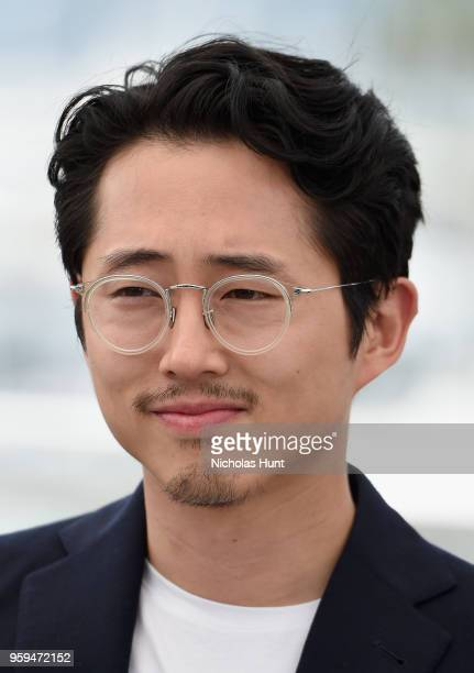 Steven Yeun attends the 'Burning' Photocall during the 71st annual Cannes Film Festival at Palais des Festivals on May 17 2018 in Cannes France