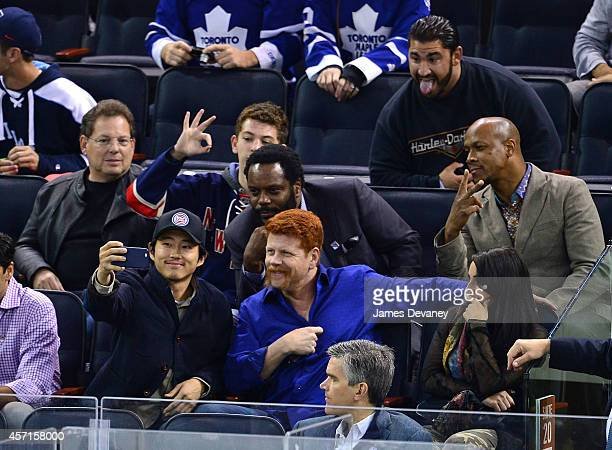 Steven Yeun Chad Coleman and Michael Cudlitz attend New York Rangers vs Toronto Maple Leafs game at Madison Square Garden on October 12 2014 in New...