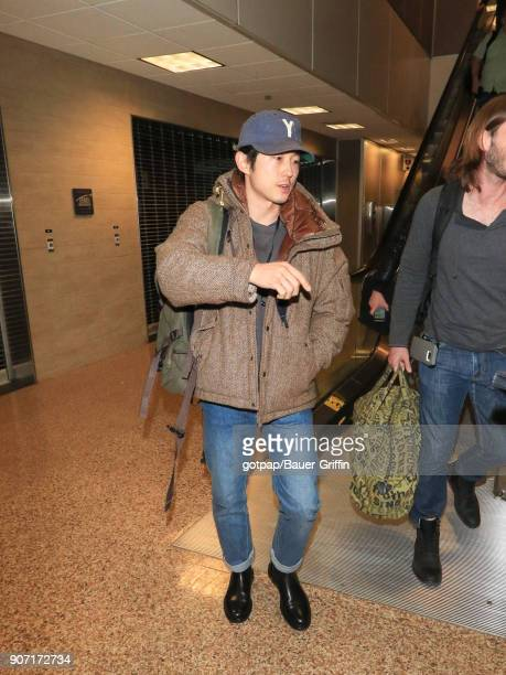Steven Yeun is seen at Salt Lake City International Airport on January 18 2018 in Park City Utah