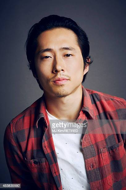 Steven Yeun poses for a portrait at the Getty Images Portrait Studio powered by Samsung Galaxy at ComicCon International 2014 on July 24 2014 in San...