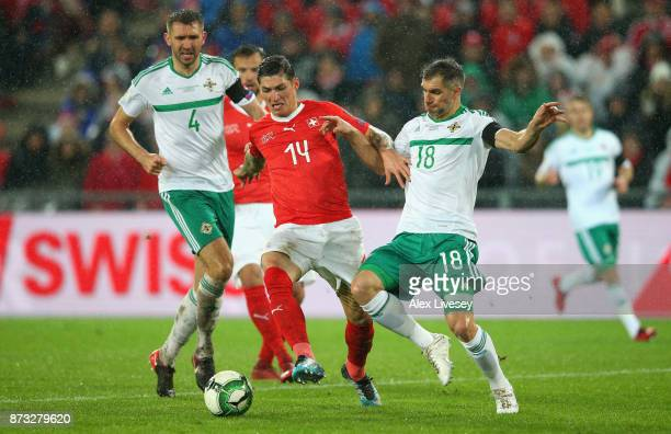 Steven Zubar of Switzerland and Aaron Hughes of Northern Ireland in action during the FIFA 2018 World Cup Qualifier PlayOff Second Leg between...